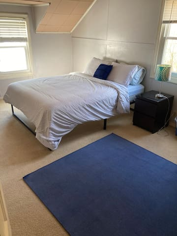 3rd bedroom with queen bed and desk.