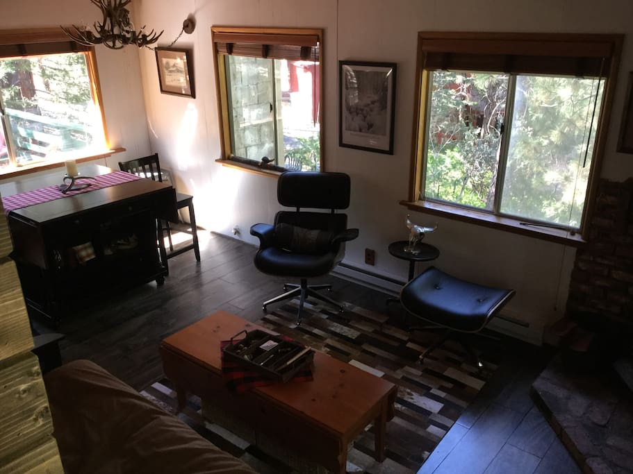 Livingroom/dining combo with wood stove.  Table seats eight for dining on games.