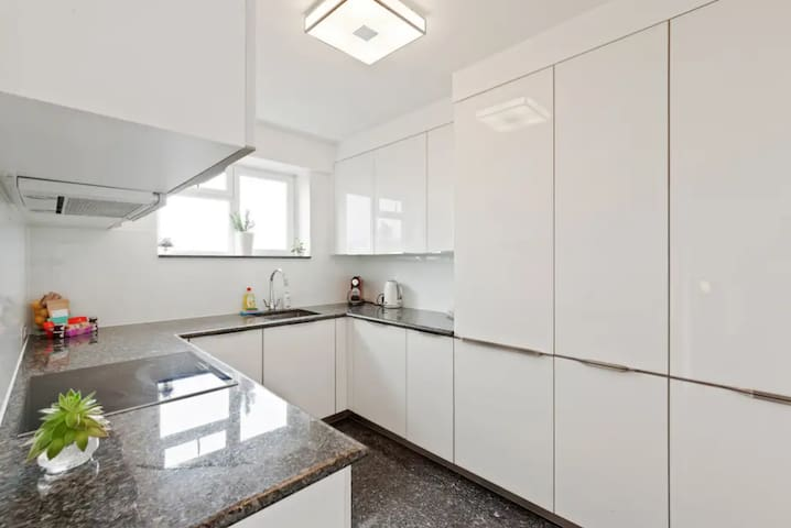 A sleek, fully-equipped kitchen...