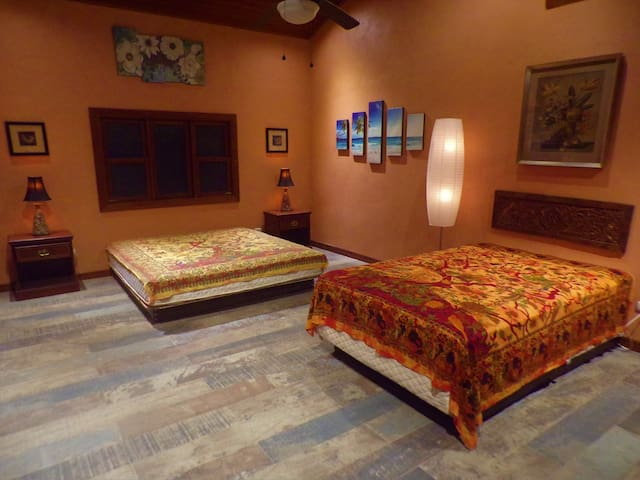This bedroom features a king bed and a double bed.