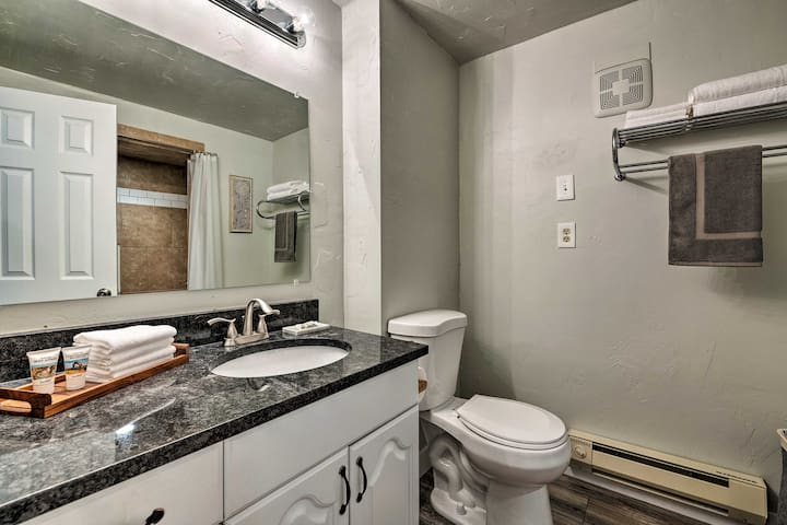 There's a large, tiled shower to complement the granite counters.