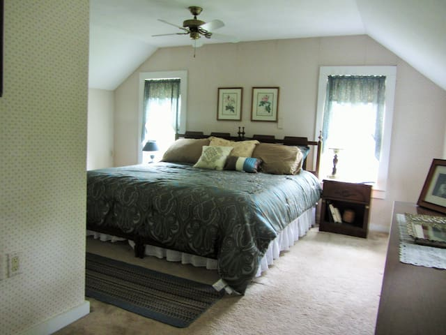 King bedroom with view of gardens and the pond