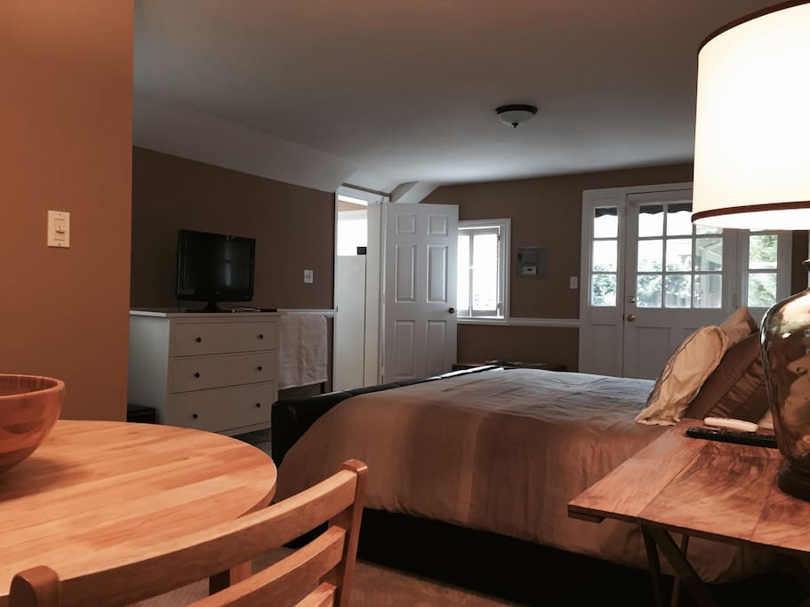 Spacious bedroom with 2 closets and king size bed and dining area.  TV access via ROKU with access to Netflix, Amazon TV, Sling TV, and Google Play.