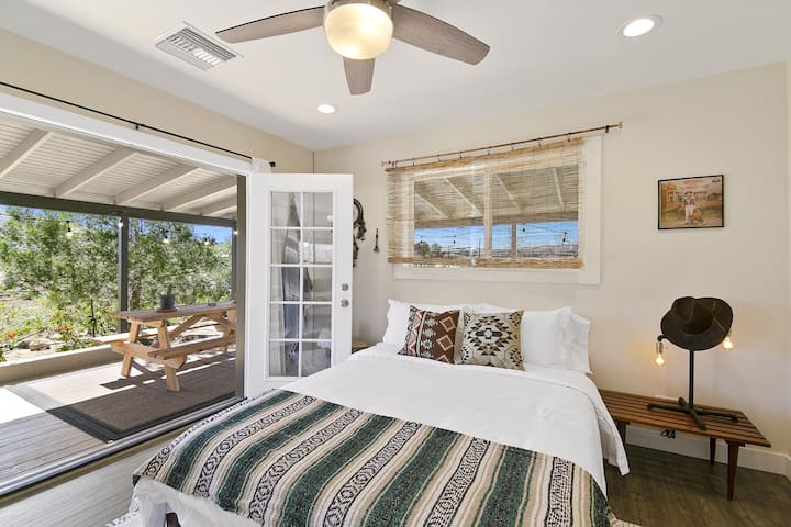 Our guest room also boasts double opening french doors that open onto our wraparound deck.