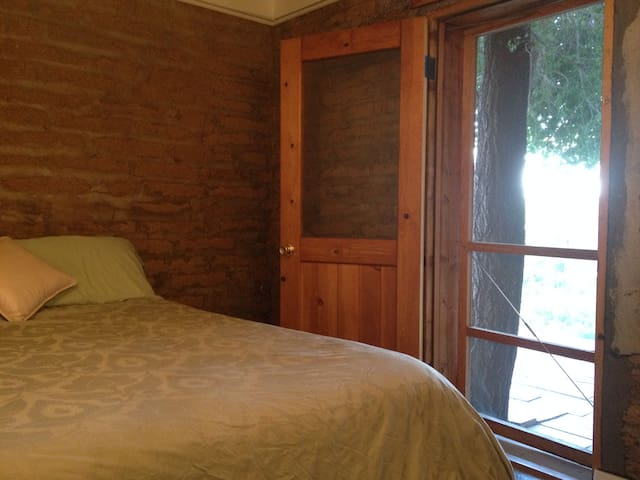Both bedrooms feature private entrances to the back patio.