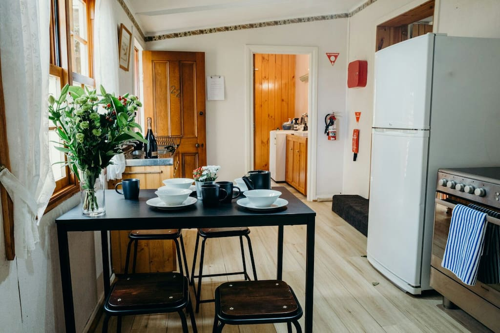 The kitchen has a microwave, kettle, oven and toaster. Crockery and cooking utensils allow guests to self-cater. The dining table seats four. We have a fantastic new oven!