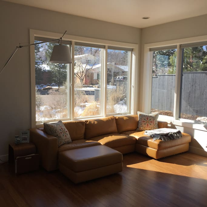 Bright and sunny front room for reading a book or relaxing.