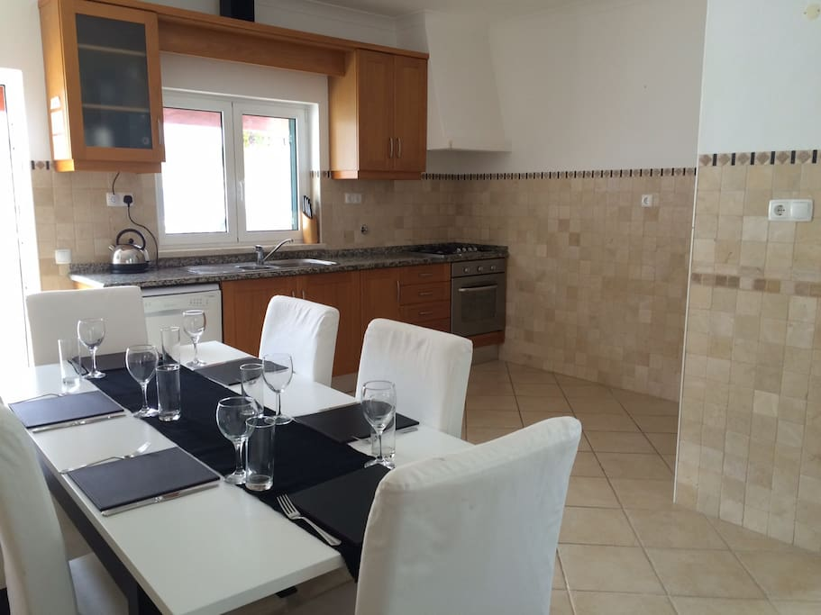Fully equipped kitchen and dining area that can comfortably seat 8 people