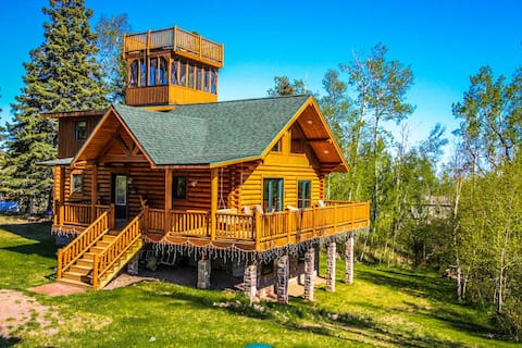 Eagles Nest is an awe inspiring log home in Tofte that will make you feel like you are living on top of the world