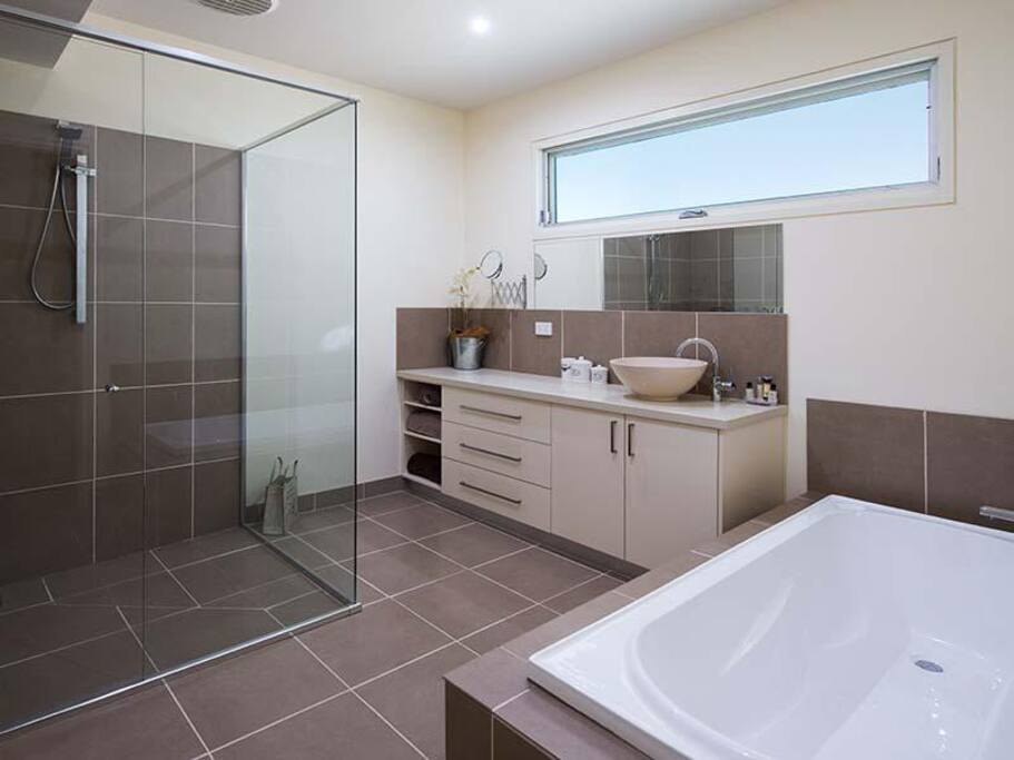 Modern Bathroom includes bath and shower.