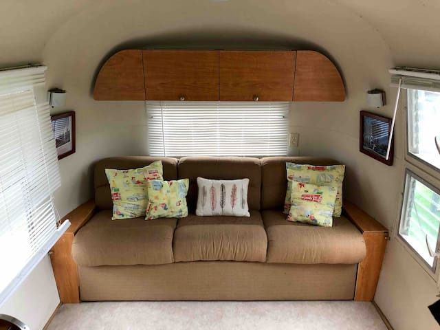 Pull out sofa can be set up for two with memory foam topper. This is approximately a full sized bed. Two twins are located mid-cabin. The Airstream is equipped with a fridge and electric fireplace heater with writing desk and chairs.