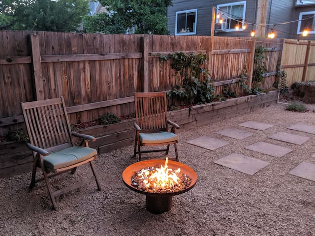 Gas fire pit in the private backyard