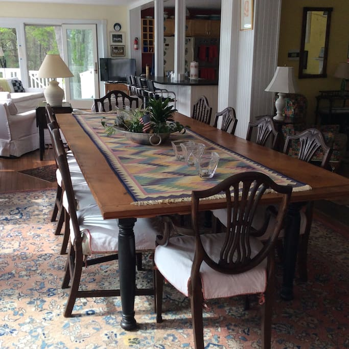 This is a fabulous dining room table that easily seats 12.  The living space of the first floor is one large room divided into four separate living sections - living room, dining room, TV room and gourmet kitchen.