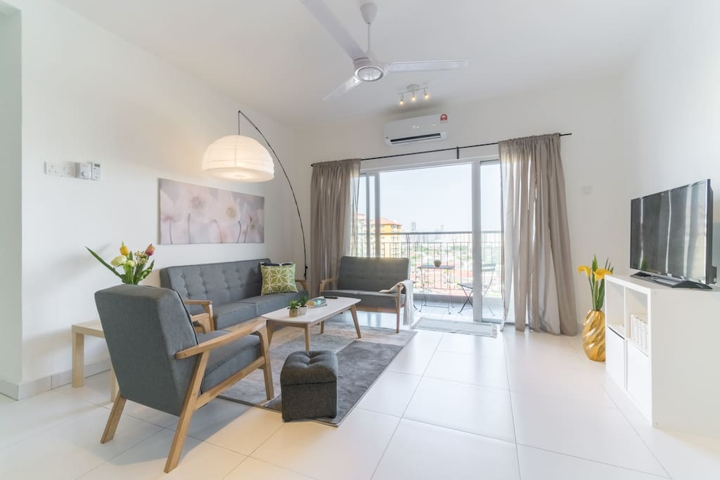 Bright living room space with big balcony