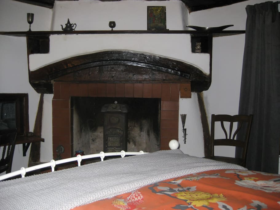 Fireplace from across the double bed