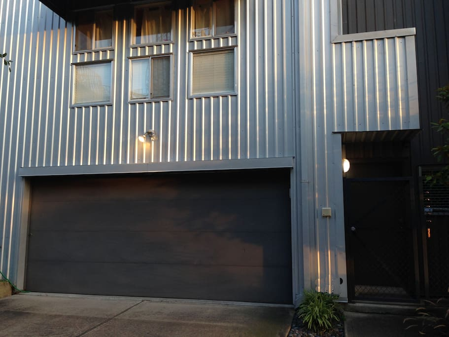 Modern, well-kept townhome in central Houston with secure gated front entrance.