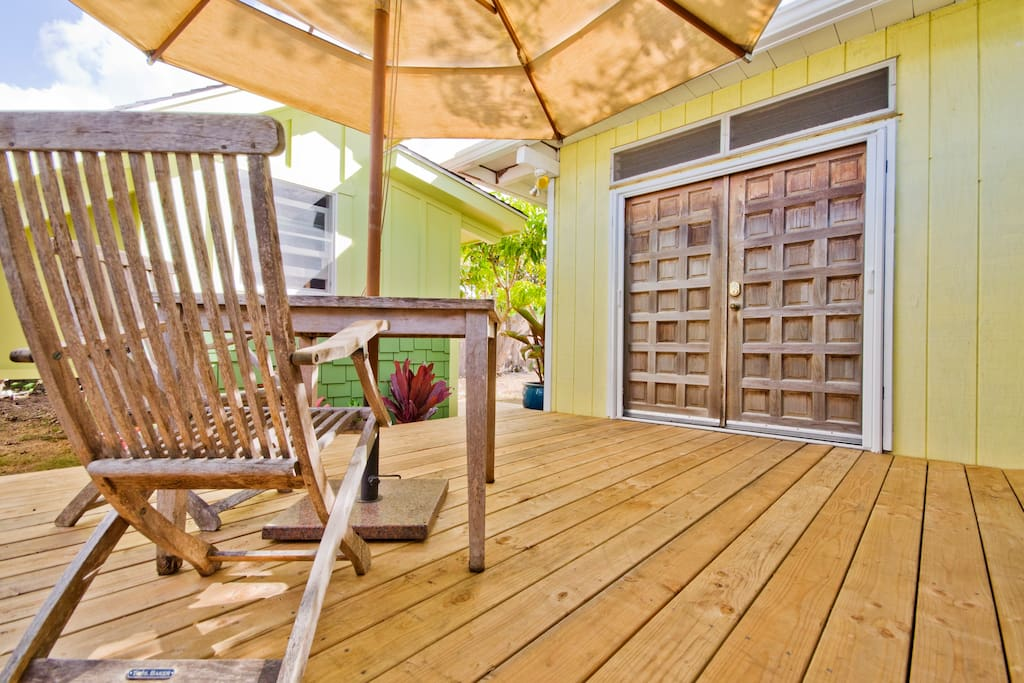 Relax under the umbrella on the side deck in front of our back doors.