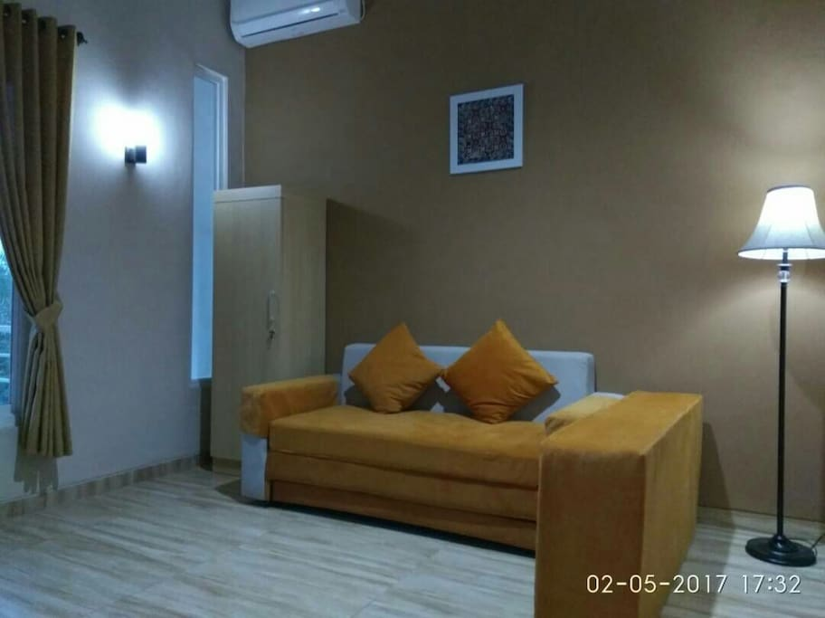 Sofa Bed in room equipped with AC and TV local channel.May be used as 2nd living room on 2nd floor