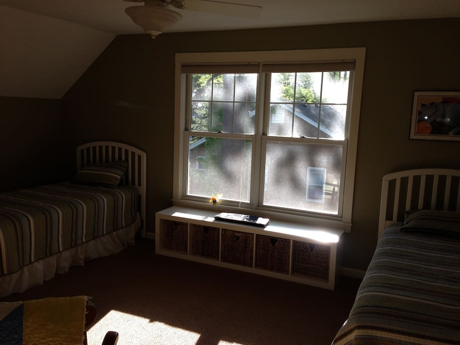 Second bedroom with two twin beds, play area for kids