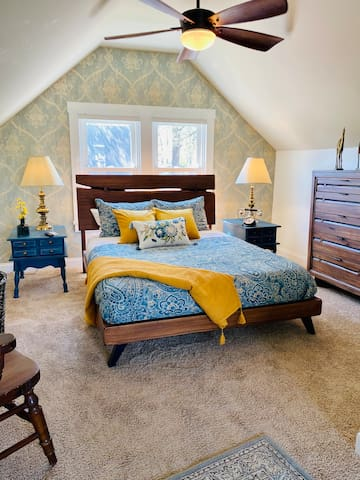 The Master Bedroom. This room is decorated w/ brand new bed and dresser and the designer mixed  it with old furniture. Really American  style. It  has a chair, TV, closet and a cozy space w/ a rocking chair for your relaxing time. No door upstairs.