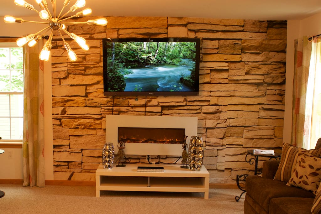 55 inch LCD can be seen anywhere on the main floor, lots of channels! Fireplace