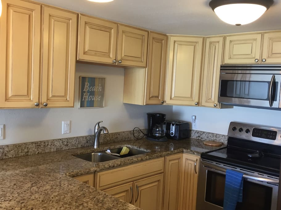 Fully equipped kitchen with coffee maker and tea hot water kettle