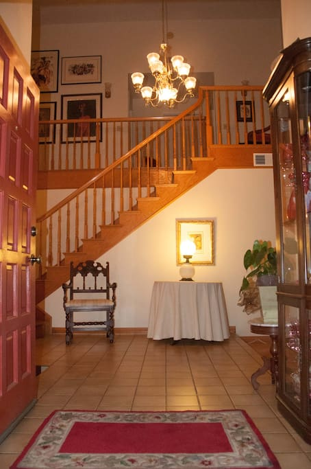 Stairway that leads to the second story and your room.