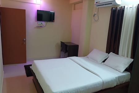 Deluxe AC Room in white pearl