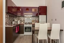 ultra modern kitchen with dining area