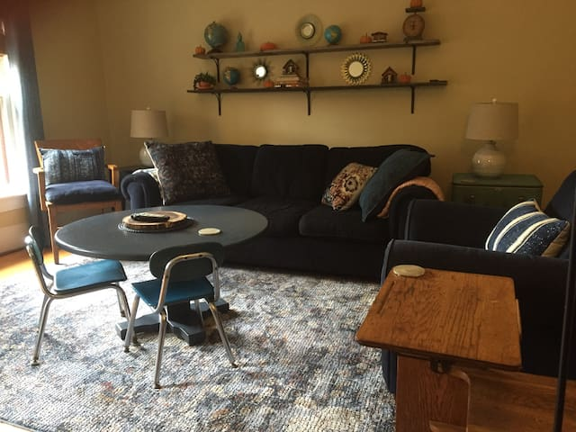 Large living room with kid  friendly area.