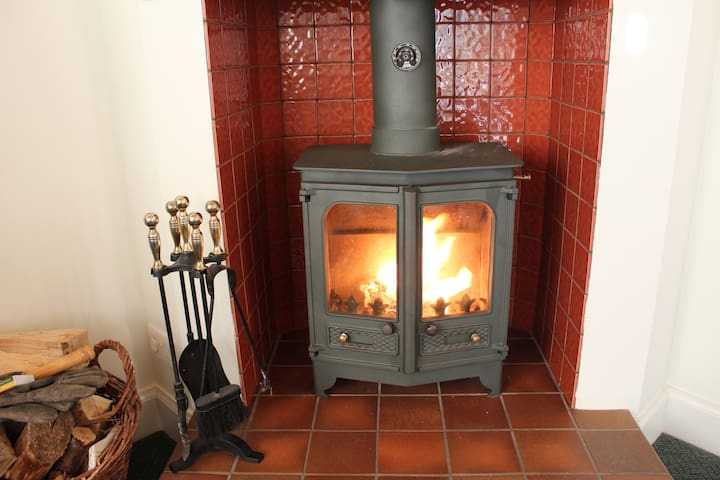 Wood burning stove to keep you cosy.