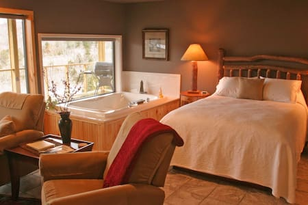 Lake View Suites have queen size beds with a large Jacuzzi tub and a window at the tub, facing the lake.