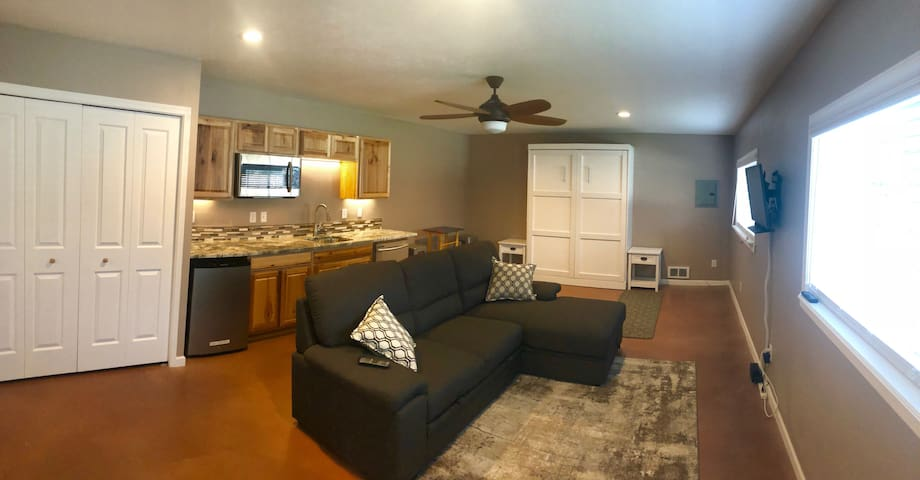 Kitchenette/Murphy Bed. Kitchenette includes mini fridge, microwave and dishwasher. Utensils and plates and coffeemaker are included. There is a small crockpot, too. There is also an outdoor grill. The couch pulls out into a full bed - for kids only.