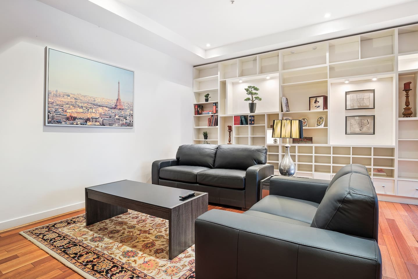 The apartment is filled with natural light located on a lower level of the building