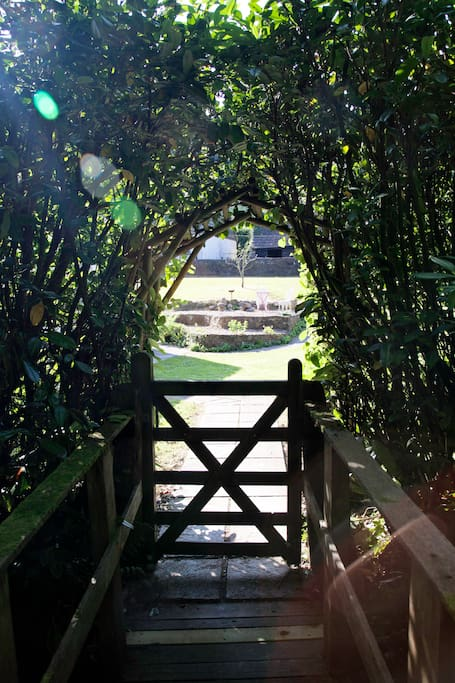 A view from the little bridge, looking into the Round House garden.