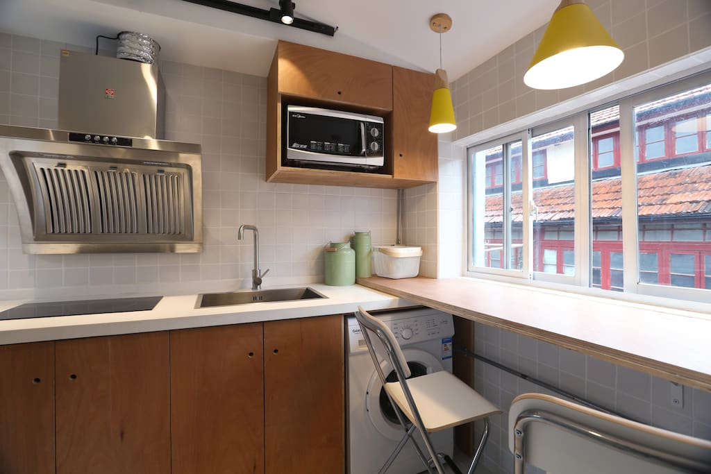 fully equipped kitchen with a western washing machine, a refrigerator and microwave etc