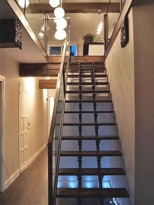 Beautiful staircase to open plan upstairs living