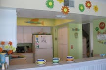 The fully stocked kitchen has a microwave, dishwasher, and loads of pots and pans for in house cooking