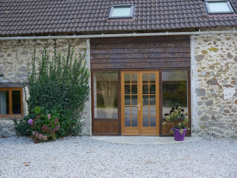 The entrance to Gîte de Vulcain with the kitchen window to the left.