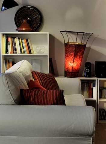 Comfy sofa with Maroccan pillows and lamp