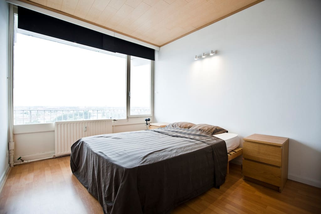 Spatious bedroom, great view.