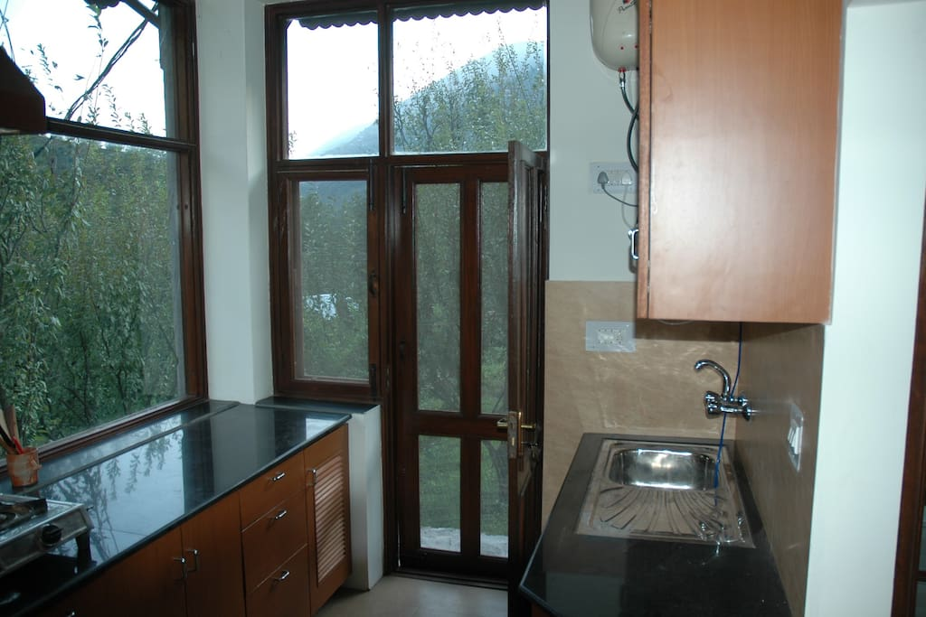 Modern fully equipped kitchen with Gas Hob, RO, Fridge, Microwave, Toaster etc.