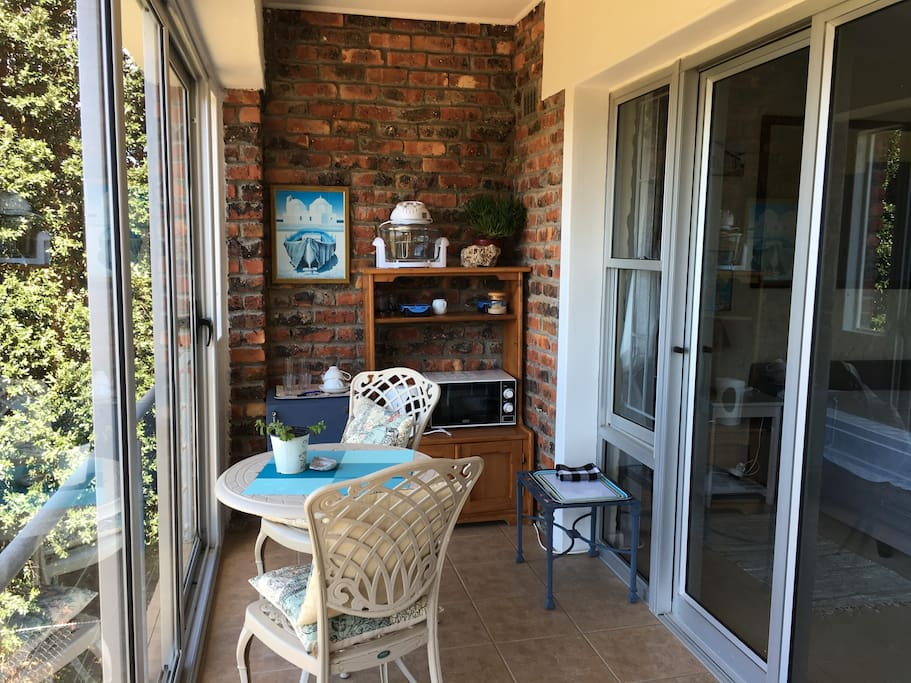 balcony with fridge, microwave oven, mini glass oven,kettle, cutlery, crockery, teas, coffees, fruit, rusks, biscuits