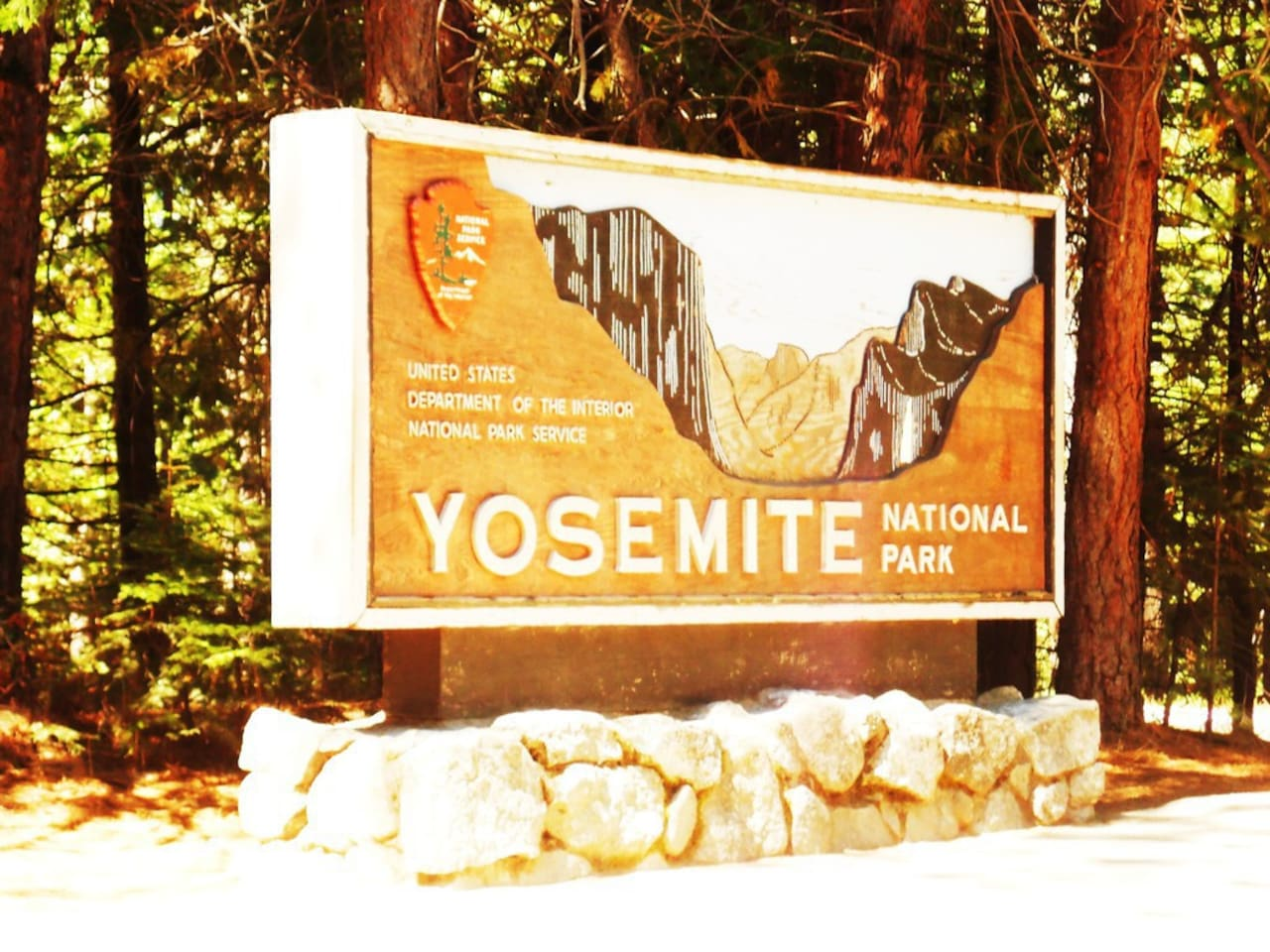 entrance sign to Yosemite National Park - 20 miles away