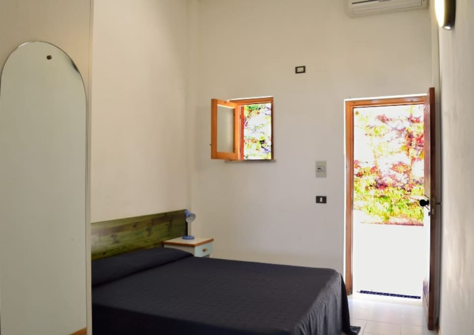 Enter and bedroom with large bed