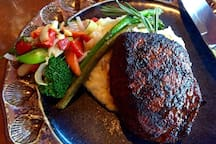 LD's Woodfire Grill is across the street.   They offers steak, seafood, wine and more -- fantastic for date nights.