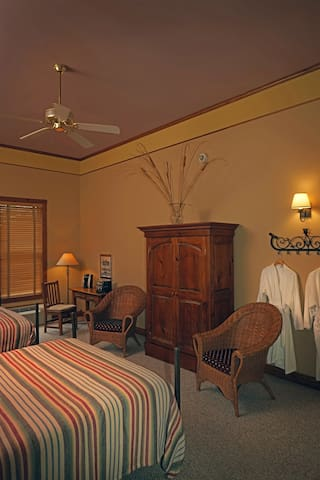 Double Queen room with robes and wardrobe