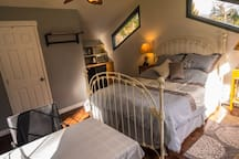 Queen bed with small table and chairs