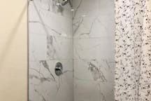 Beautiful tiled marble shower. Sparkling clean and new