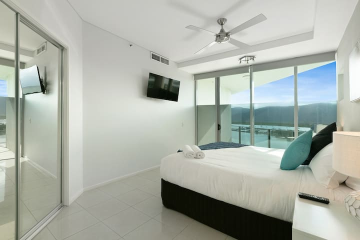 In the third bedroom, sleep easy in a premium king-sized bed with a TV, large wardrobe and balcony access.
